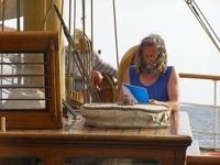 Captain Kraas reading papers.jpg